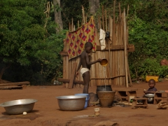 Village boy filling up the water bucket; Boabeng