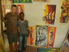 Robby posing with one of Joel's helpers alongside his beautiful artwork