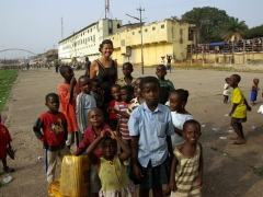 Becky getting mobbed by Kumasi kids eager to have their photo taken