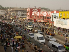 Main street intersecting Kumasi's massive central market