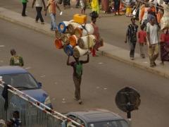 Balancing a precious load of empty barrels; Kumasi