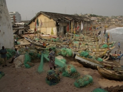 "Colorful fishing boats now line the beachfront just outside Cape Coast Castle's ""Door of No Return"""