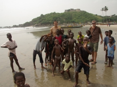 The kids of Saltpond are a super friendly bunch, crowding Luke and Robby on the beach