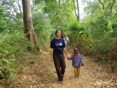 A friendly village boy runs up to Becky to hold her hand while walking through the Boabeng-Fiema monkey sanctuary
