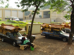 Funeral hearses line the roadside in Kumasi