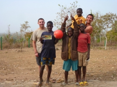 Dowelly and Luke pose with their fellow soccer players at Mole National Park