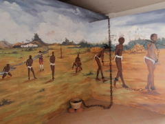 Depiction of the slaves who had to walk for miles to be centrally located at the slave forts in Ghana before being shipped out across the Atlantic; Fort Ussher museum