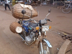 Chicken baskets loaded to a motorcycle in Tamale