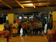 The friendly staff of Coral View Resort singing songs for our evening entertainment