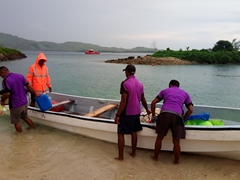 Coral View staff offloading our luggage; Tavewa Island
