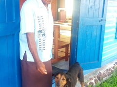 The friendly pastor and Rambo (his dog) invite us for church; Tavewa Island