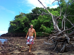 Robby checking out the volcanic area marking the end of the sandy beach; Nacula Island