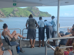 Fijian school boys wearing a sulu (long skirt) as part of their uniform; South Sea Cruises