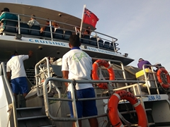 Disembarking South Sea Cruises onto the transfer boat to Bounty Island Resort
