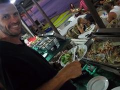 "Enjoying a Fijian ""lovo"" (feast cooked in the earth)"