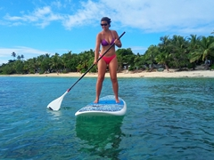 Becky taking advantage of Bounty Island's free paddle boards