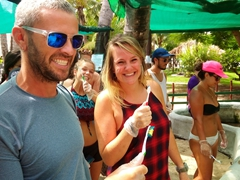 Robby and El Kie holding up their toothbrushes for turtle cleaning time; Bounty Island Resort