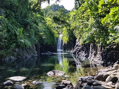 At long last, the waterfall is in sight at the end of the Lavena Coastal Walk