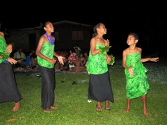Village girls sing and dance for our meke performance
