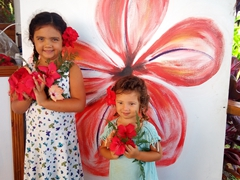 Gracie and Emma posing with our breakfast flowers; Makaira Resort