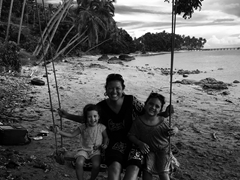 Swinging with Emma and Gracie near Jean-Michel Cousteau Resort