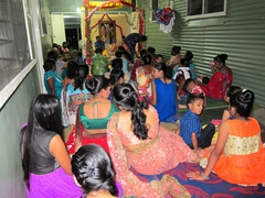 Getting invited to a Hindu festival at our caretaker's house - vinaka to Subas & Sunita!