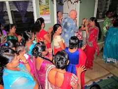 Bob dancing with the ladies to their amusement and delight