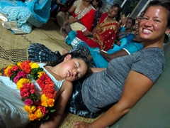 An exhausted Grace falls asleep mid ceremony at the Hindu festival celebration