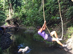 Becky swinging across the river