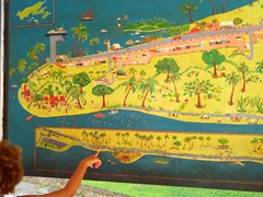 A Fijian child points out where his house is on this Savusavu map at the airport
