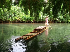 Poling a bilibili (traditional bamboo raft)