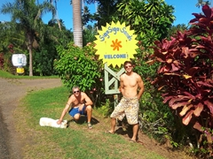 Robby and Luke by the signpost of our awesome home for 2 weeks - Siga Siga Sands