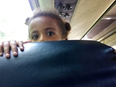 Getting checked out by a local girl on the bus from Nadi to Pacific Harbour