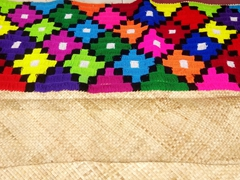 Colorful woven mat for sale at Suva's craft market