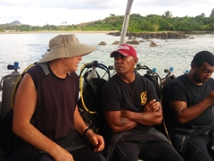 "Bob getting chummy with Ben (whose claim to fame is winning ""Mr Fiji"" bodybuilding championship seven times); Beqa Adventure Divers (BAD)"