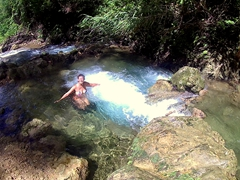 Becky enjoying our natural plunge pool; Mele Cascades
