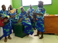 A string band welcomes us to Vanuatu