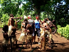 Getting attacked by the villagers...our guide told us that cannibalism was practiced up until the 1960s and that humans taste like chicken!
