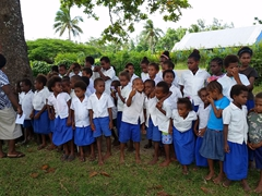 Ekonak primary school children gather to sing us songs