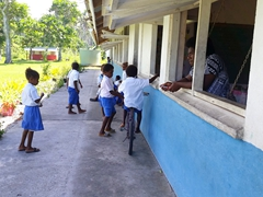 The school kids go back to playing after our visit