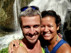Smiling as we reach the base of the 115 ft waterfall - impressive!