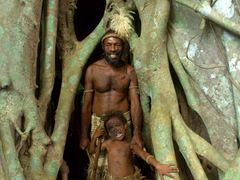 Tribal chief and his daughter pose in the banyan tree; near Buraoloa