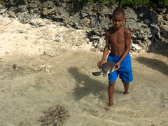 Ni-Vanuatu boy shows off his pet turtle