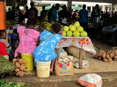 Vendors sit on buckets as they patiently wait for a sale