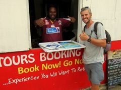"Stewart and Robby flash the thumbs up after he successfully talks us into an ""around the island"" tour with his auntie's company; Port Vila"