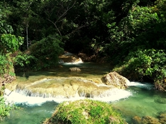 From the entrance, its an easy 20 minute hike past  turquoise pools to reach the main waterfall; Mele Cascades