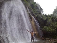 The upper waterfall consists of two large waterfalls. Robby enjoys a back massage from this behemoth