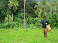 A Ni-Vanuatu girl smiles as we offer to buy a cocoa  fruit from her