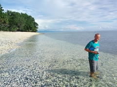 Robby admiring the crystal clear water at Waterfall Village's beach