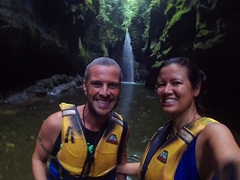Smiling in the middle of our float down the Sarakata River